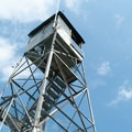 The fire tower hosts great views.- Adirondack Fire Tower Hikes