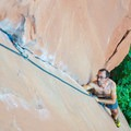 Climber following a trad route near Moab, Utah.- How to Get Into Rock Climbing and Where to Start