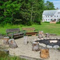Group campfire area outside Cardigan Lodge.- Incredible Mountain Huts + Lodges in New England
