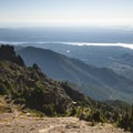 View east from the summit of Mount Ellinor (5,952 ft) with the Hood Canal and distant Mount Rainier (14,411 ft).- Best Vistas for Fireworks: Seattle, WA