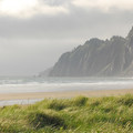 View looking north toward the base of Neahkahnie Mountain form Manzanita Beach.- Sink Your Toes into Miles of Sand