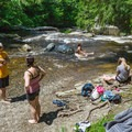 Relax in the cool flowing waters of True's Brook at True's Ledges in New Hampshire.- Perfect Summer Escapes to Cool Off in New England