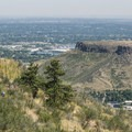 View east from the Windy Saddle Trailhead with hikers on the Chimney Gulch Trail.- Best Vistas for Fireworks: Denver, CO