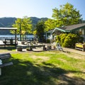 Lake Cushman Resort general store and outside deck.- Best Lake + River Camping in Washington