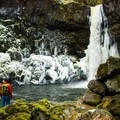 Admiring the view of the 69-foot Outlet Falls from below.- Washington's Best Winter Waterfalls