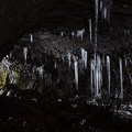 Illuminated stalactites in Guler Ice Caves.- Amazing Western Caves and Tips for Exploring