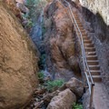 The stairwell descending to the Bear Gulch Caves from the Bear Gulch Reservoir dam.- Bear Gulch Caves