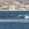 Surfers at Surfrider Beach, Malibu Lagoon State Beach.- Southern California's Best Beaches