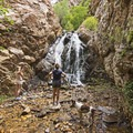 Exploring the waterfall in Heughs Canyon.- Heughs Canyon Trail
