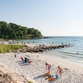 Spend a whole day enjoying the warm waters and soft sand at Falmouth's Old Silver Beach.- Incredible Coastal Adventures in Massachusetts