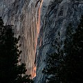 As the sun sinks lower and its lingering rays turn redder, Horsetail Fall begins to look like a lava flow.- Winter in Yosemite National Park