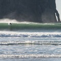 Surfer at Pacific City, Oregon.- The Pacific Northwest
