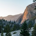 The last rays of light casting a fiery glow on the granite cliffs.- Yosemite National Park