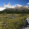 The trail crosses marshlands with Fitz Roy in background.- Laguna de los Tres