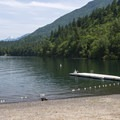 Swim beach and dock at Maple Bay Day Use Area with Cheam Peak (2,104 m) in the distance.- 5 Reasons Why You Should Spend a Weekend at Cultus Lake