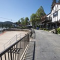Lake Arrowhead Village promenade. Note the orange fence on the beach prohibiting swimming.- 5 Reasons to Explore Arrowhead Lake