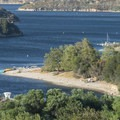 View of the main day use area and swim beach at Silverwood Lake State Recreation Area.- Guide to Silverwood Lake Recreation Area