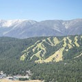 View south to Snow Summit Ski Resort and San Gorgonio Mountain (11,502 ft) from the summit of Bertha Peak.- California's 60 Best Day Hikes