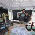 Outdoor Project's Eddie Rosenberg and Kat Dierickx manning the OP tent.- Outdoor Project's Bend Block Party 2017