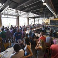 Crowds gather inside the Denver Beer Co. tap room.- Outdoor Project's Mile High Summer Shindig Denver Block Party