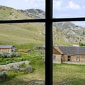 View of Bannack through the second floor windows of Hotel Meade.- The Uninhabited West: Ghost Towns and Mines