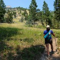 The rocky peak of Storm Castle looms high above you early on the trail.- 14 Hikes in Greater Yellowstone