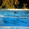 A body surfer waits for a set at Trinidad State Beach.- Best West Coast Beaches for Beginner Surfers