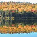 View from the Grout Pond Campground.- The Ultimate Fall Foliage Road Trip in Vermont