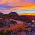 Vibrant sunrise over Perfection Lake with Prusik Peak to the left.- Prusik Peak: West Ridge