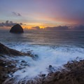 If the conditions are right, waves can crash high up onto the westernmost point of the Cape Kiwanda.- Safety on the Oregon Coast: Sneaker Waves, Cliffs + More