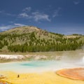 Imperal Geyser with Twin Buttes in the background, Yellowstone.- America's Best National Parks for Fall Foliage and Wildlife