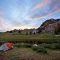 Camp near a small pond below Trail Rider Pass in Maroon Bells-Snowmass Wilderness.- Wander Among Wilderness Areas
