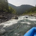 Entering a rapid on the Middle Fork of the Flathead River near Glacier National Park.- 10 Great Rafting Trips in the Rocky Mountains