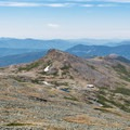 Mount Monroe and Lakes of the Clouds Hut from below the summit of Mount Washington.- Take the High Road in 2019: Geotab Maps America's Highest Roads