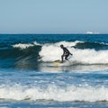Surfing at Jenness State Beach.- 20 Must-Do Summer Adventures in New Hampshire