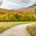 The wide, gently rolling trails at Great Glen Outdoors Center in New Hampshire, shown during the fall turn, make it easy for the whole family to enjoy a snowshoe or cross-country skiing adventure.- 8 Winter Adventures in New England Perfect for the Whole Family