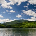 The MacIntyre Range as seen across the lake.- 12 New York Lakes Perfect for Summer Adventure