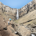 Climbing over rocks to get closer to Hengifoss.- 14 Must-Do Activities In Iceland