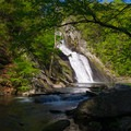 High Falls in the distance. A short rock hop gets you there.- 10 Must-See Waterfalls in New York
