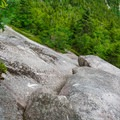 Looking down the steep slab on the Holt Trail on Mount Cardigan.- 20 Must-Do Hikes in New Hampshire