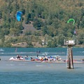 Kiteboarders on The Spit in Hood River.- A Beginner's Guide to Kiteboarding