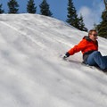 Going down the Snoqualmie Pass sledding hill at Summit West.- Winter Retreat at Snoqualmie Pass
