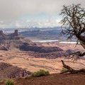 Potash evaporation pools can be seen in the distance at the Rim Trails Loop.- Canyonland Country: Best Hikes Near Moab