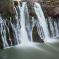 The waters collect silt during large rains, changing the colors of McArthur-Burney Falls.- 25 Can't-Miss Waterfalls in California