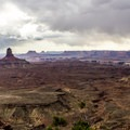 Needle Butte in the distance from False Kiva.- Canyonland Country: Best Hikes Near Moab