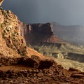 Light breaking through the clouds on the False Kiva.- 50 Favorite Hikes in Utah