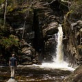 Contemplating a dip in the pool below Kinsman Falls near Lonesome Lake.- New Hampshire's Best Lakes for Summer Adventure
