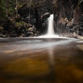 The water is stained a rust color by tannins at Kinsman Falls.- 20 Must-Do Hikes in New Hampshire