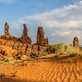Climbing sand dunes near Tower Arch.- Canyonland Country: Best Hikes Near Moab