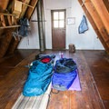 Loft sleeping area with flaps down for additional sleeping space at Ludlow Hut.- Glamping